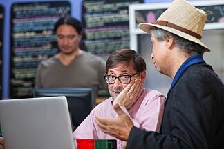men_with_laptops