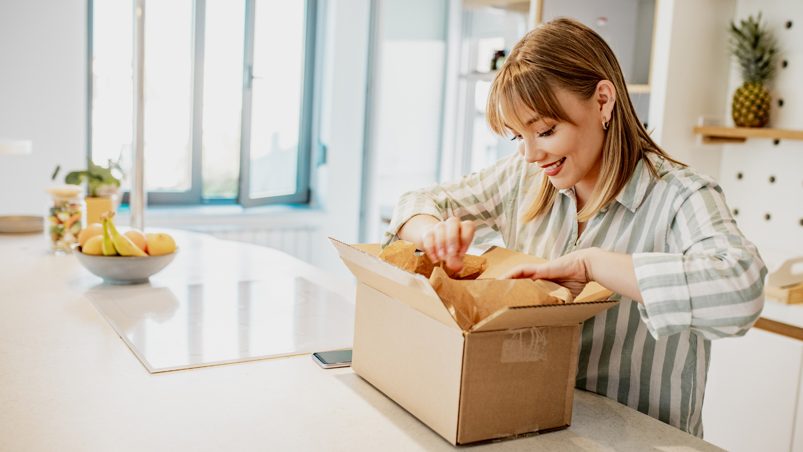 oung woman unpack the package she ordered online